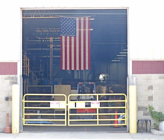 An American flag hangs inside the Mid-America Steel Drum plant on S. Pennsylvania Avenue in St. Francis. The company is installing new pollution-control equipment.