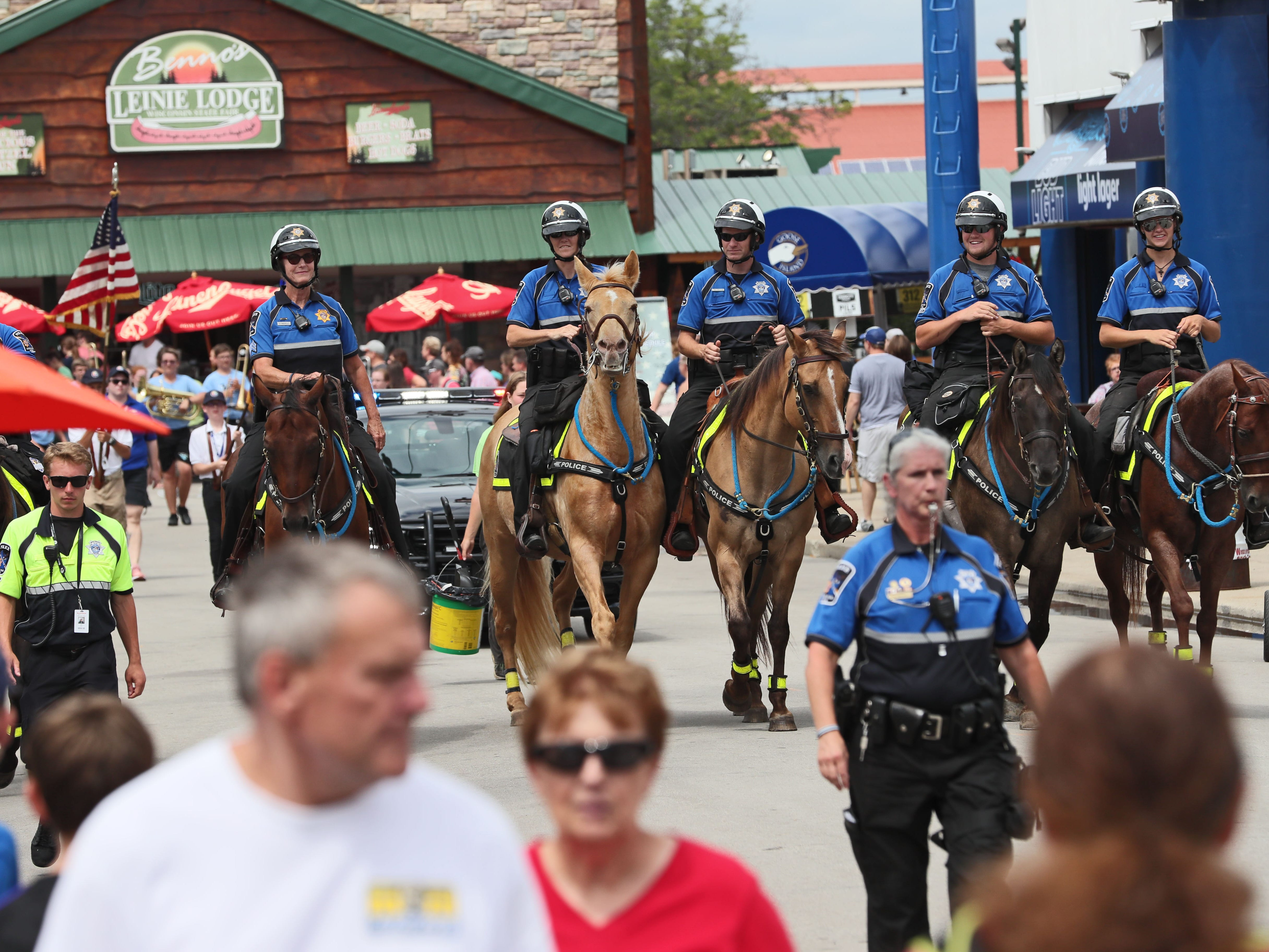 The mounted patrol makes its daily parade through State Fair Park in West Allis during the Wisconsin State Fair. Riders must fulfill three criteria: have extensive training (the unit doesn't offer it); own a horse that can tolerate the pandemonium of the fair; and possess police or reserve officer certification.