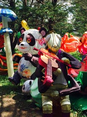 A grasshopper and panda are among several pre-assembled lanterns waiting to be installed in one of 45 lighted displays planned for the China Lights: Panda-Mania lantern festival Sept. 21 to  Oct. 21 at Boerner Botanical Gardens.