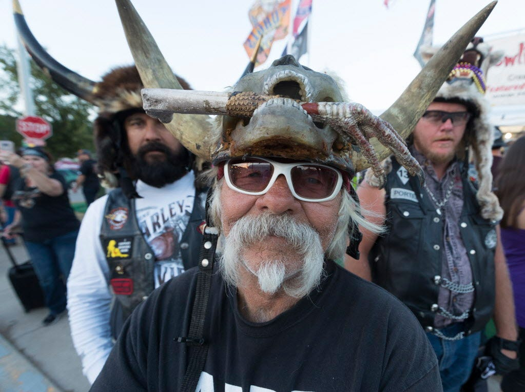"""""""Badger"""" Bob Huddleson of Vista, Calif.,  sells headware made from animals Tuesday during the  78th Sturgis Motorcycle Rally in Sturgis, S.D."""