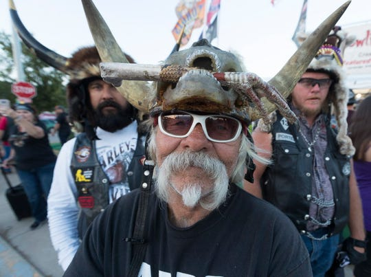 """Badger"" Bob Huddleson of Vista, Calif.,  sells headware made from animals Tuesday during the  78th Sturgis Motorcycle Rally in Sturgis, S.D."