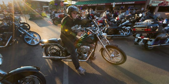 Henry Longbrake of Garden City, Calif., pulls out of his  parking spot Tuesday in Sturgis, S.D.