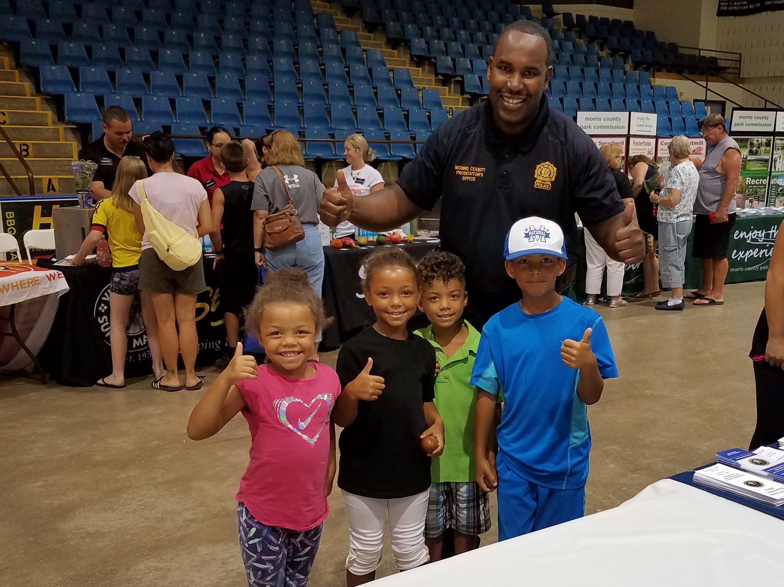Detective Supervisor Patrick LaGuerre makes friends during the National Night Out event at Mennen Arena on Tuesday, August 7, 2018.