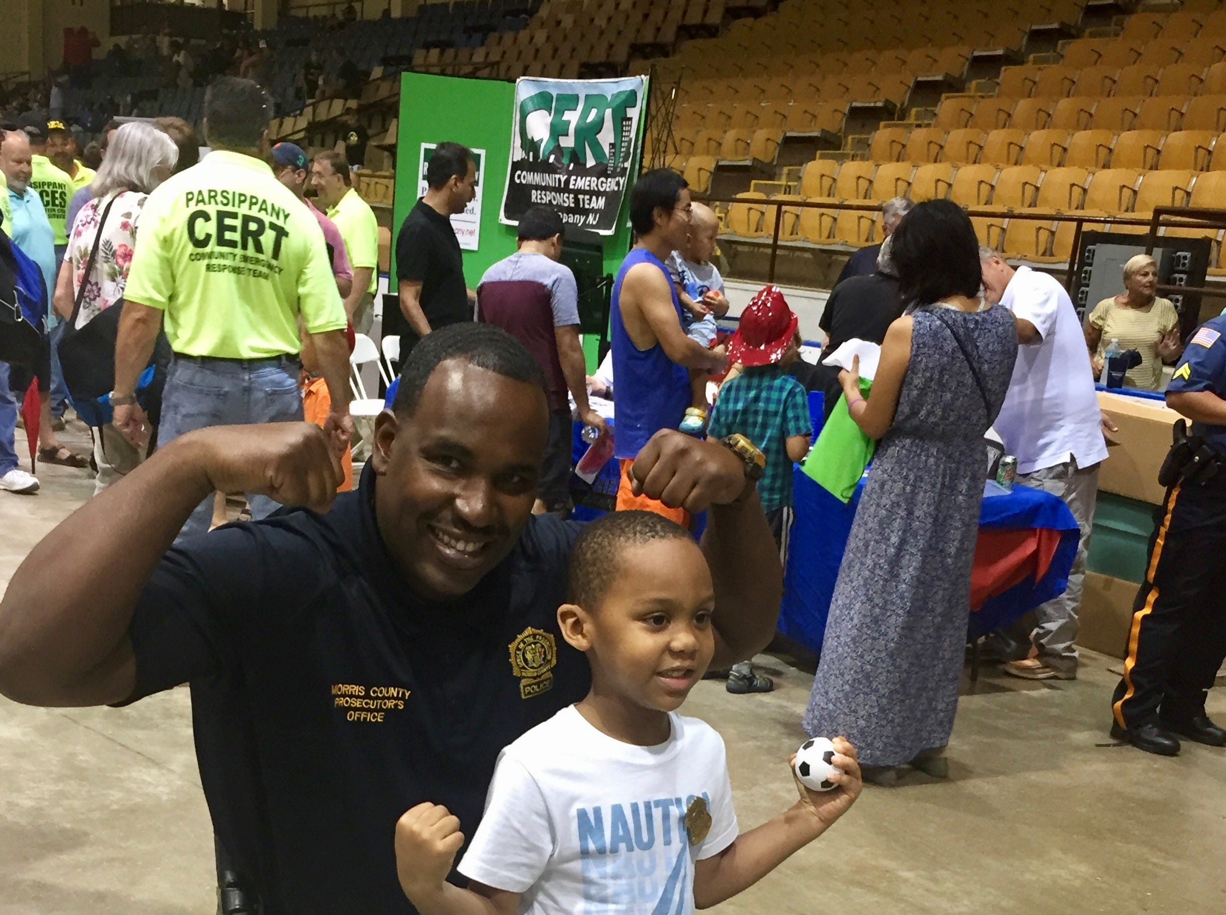Det. Sup. Patrick LaGuerre with a young fan at the National Night Out event at Mennen Arena on Tuesday, August 7, 2018.