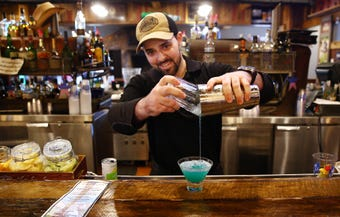 Bartender Cory Elias of Parsippany prepares drinks for a during the Dog Days of Summer to quench thirsty customers at the Rockaway River Barn.