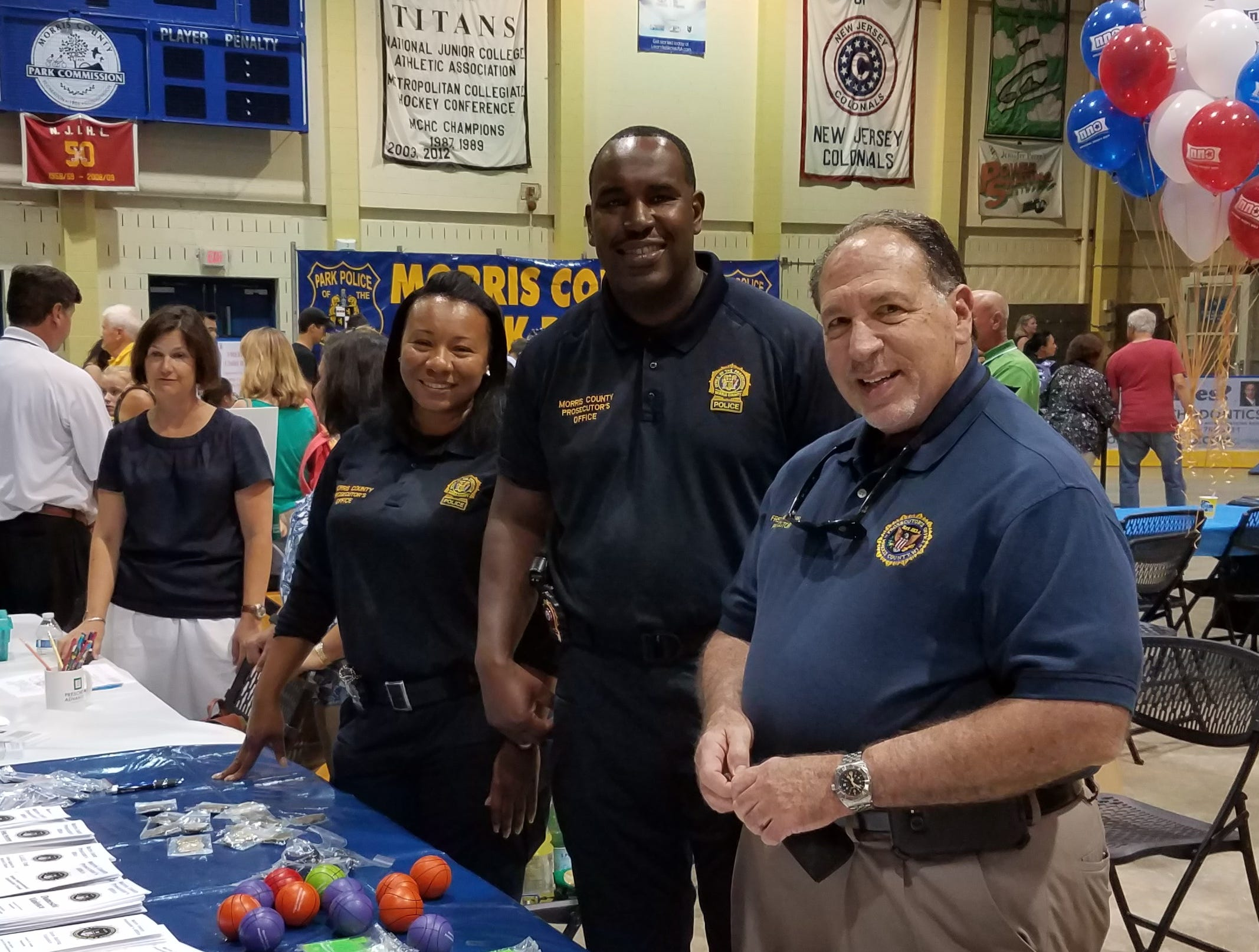 Prosecutor Fredric Knapp, Sgt. Keisha Higgs and Det. Sup. Patrick LaGuerre at the National Night Out event at Mennen Arena on Tuesday, August 7, 2018.