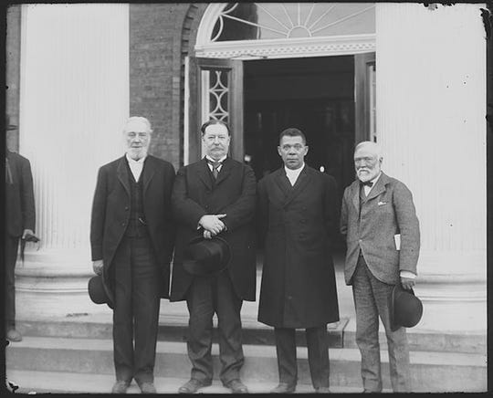 ADVANCE FOR THURSDAY AUG. 9, 2018-- Robert C. Ogden, William Howard Taft, Booker T. Washington and Andrew Carnegie, left to right, stand on the steps of a building in April 1906 during the 25h anniversary celebration of what is now Tuskegee University in Tuskegee, Ala. Taft would later become president. The event was held at the same time a Southern heritage group, the United Daughters of the Confederacy, was raising money to erect a Confederate monument that was dedicated in 1909 and still stands at the center of the mostly black city. (Frances Benjamin Johnston/Library of Congress via AP)