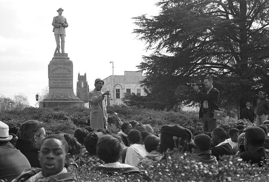 This undated photo provided by the Alabama Department of Archives and History, from 1966 shows Frank Toland, a professor at what is now called Tuskegee University, speaking to protesters gathered around the Confederate monument in Tuskegee, Alabama. Demonstrators protesting the shooting death of a black man later attempted to pull down the monument, which remains in the mostly black city. (James Peppler/Alabama Department of Archives and History via AP)