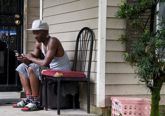 Nicholas Washington sits on the porch at his mothers home in the Litchfield neighborhood in Montgomery, Ala., on Tuesday August 7, 2018. Litchfield, finished in 1998, was the first Habitat for Humanity neighborhood built in Montgomery.