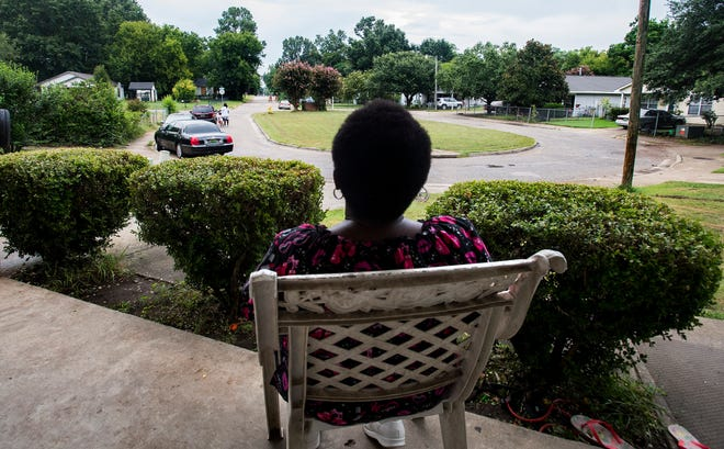 Brenda Pinkston sits on her front porch in the Litchfield neighborhood in Montgomery, Ala., on Tuesday August 7, 2018. Litchfield, finished in 1998, was the first Habitat for Humanity neighborhood built in Montgomery.