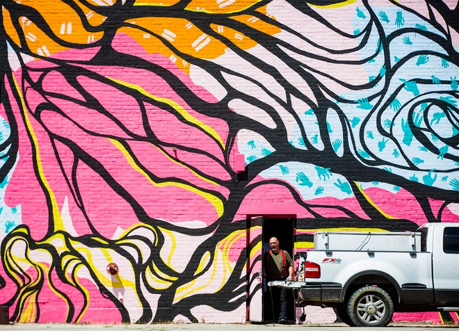 A mural painted through Muncie's We're Trying Collective on Walnut Street.