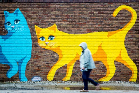 A mural outside of Two Cats Cafe in The Village.