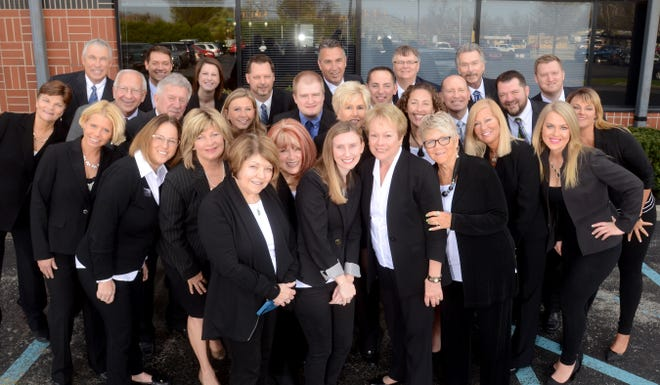 The staff of Coldwell Banker Lunsford of Muncie, which is merging with Coldwell Banker The Real Estate Group.