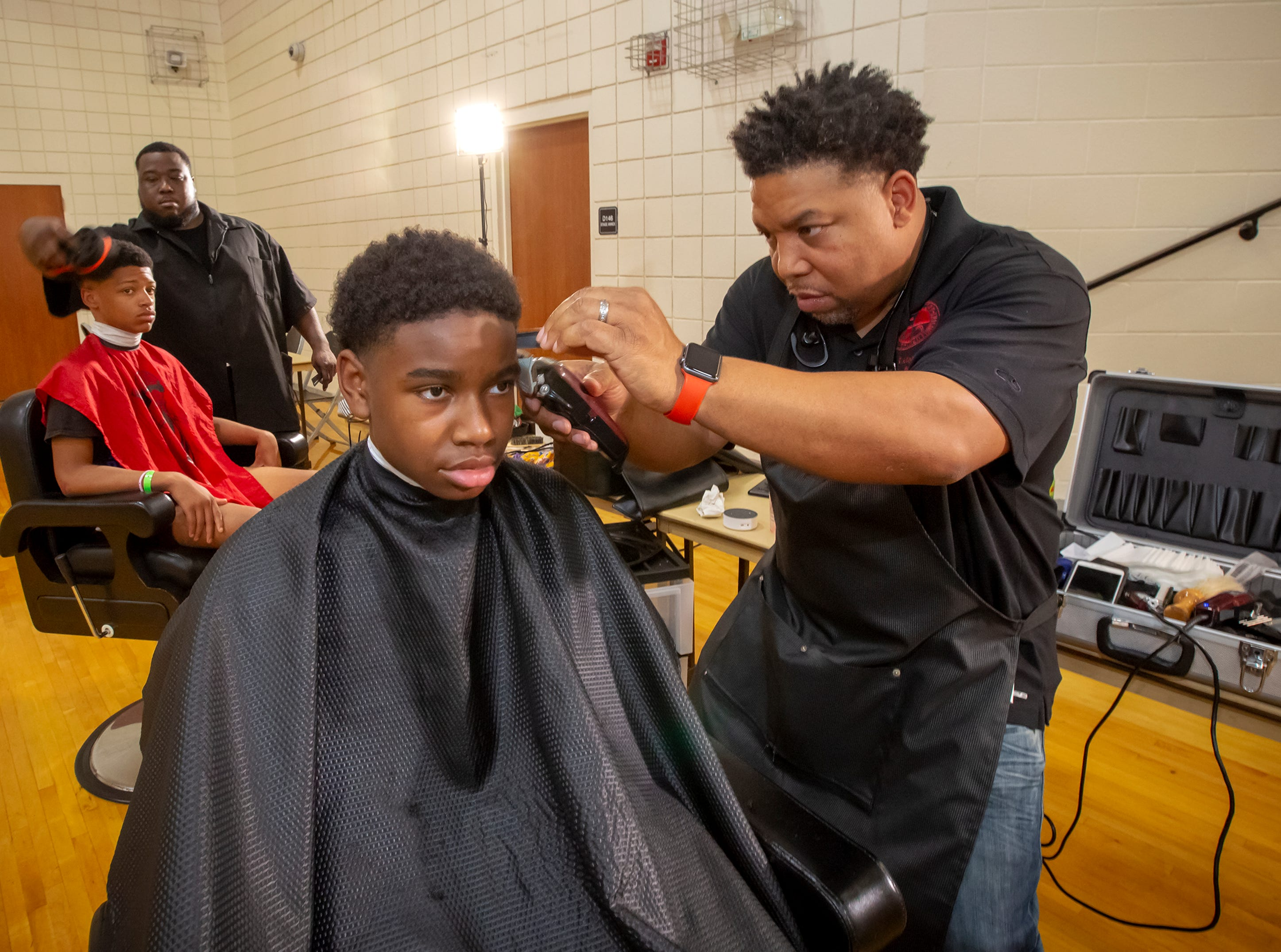Area barbers provided free haircuts at the National Night Out celebration held at Patterson Park Community Center in Murfreesboro on Tuesday, Aug. 7.