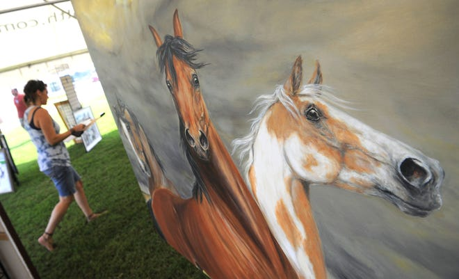 Paintings of horses wait for auction bidders during a past Raise the Roofs fundraiser for the Park at Harlinsdale Farm. This year's event is set for Saturday, Aug. 18.