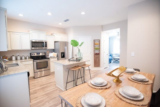 This kitchen at Ole South's Villas at Indian Creek in Murfreesboro has an island, granite and stainless appliances.