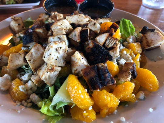 The Home Sweet Home salad comes with grilled chicken, mandarin oranges, blue cheese crumbles and chopped pecans atop romaine lettuce.