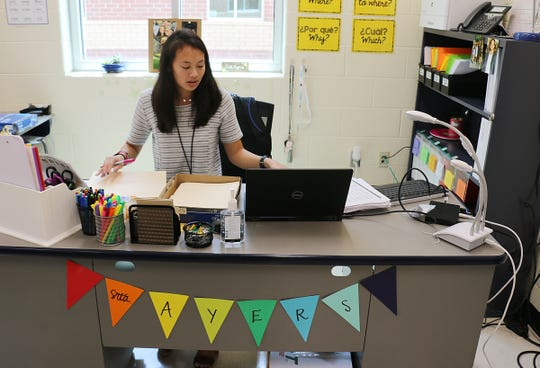 Emily Ayers works on creating students files inside her new classroom at Thompson's Station Middle School on Aug. 8, 2018.