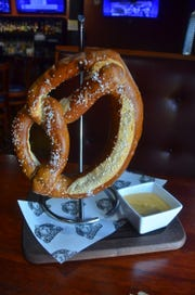 The Hunka Hunka PRetzel at Chubb's comes with BriarScratch Brown Beer Cheese dipping sauce.