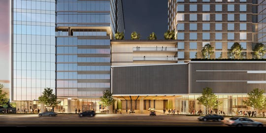 A rendering shows the front entrance to the Gulch Union office building under construction at the former Deja Vu strip club site.