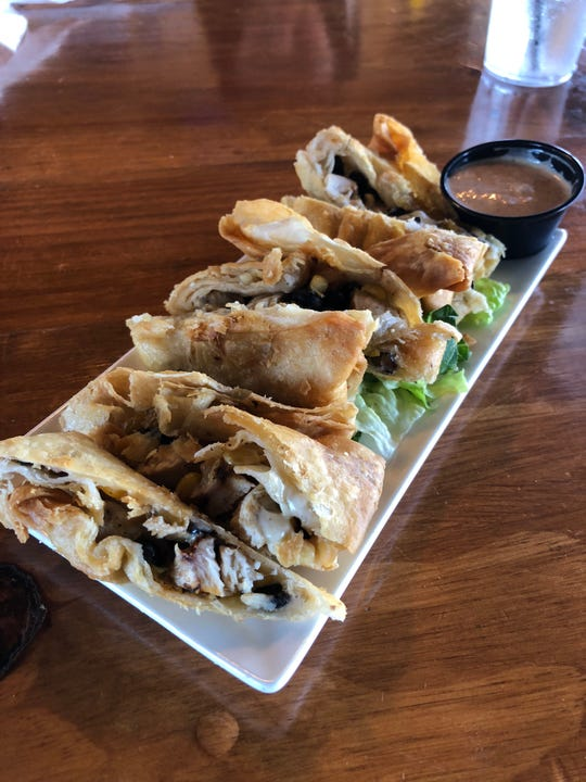 The Southwest Egg Rolls make a nice start to your lunch with black beans, corn, grilled chicken and cheese, rolled up and fried to perfection.