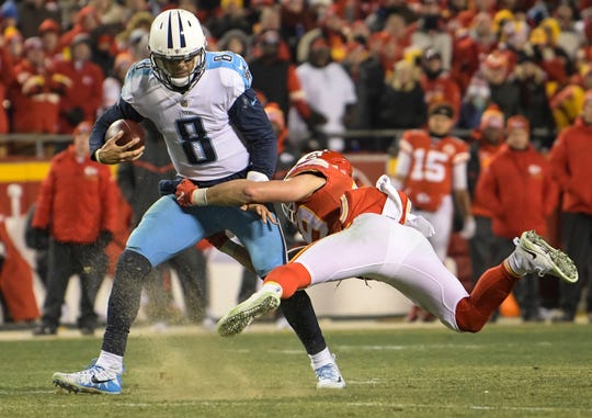 Titans quarterback Marcus Mariota (8) is tackled by Chiefs strong safety Daniel Sorensen (49) during a two-point attempt during the second half.