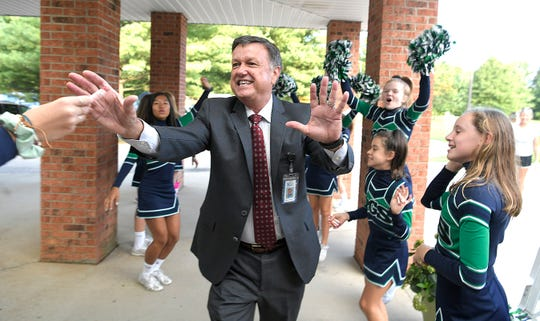 FSSD Director of Schools Dr. Snowden walks through Poplar Grove School cheerleaders' welcome back cheer line on the first day of school in Franklin on Wednesday, August 8, 2018.