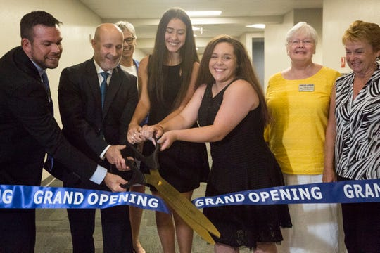 Student government presidents of Bonita Springs High School cut the ribbon marking the grand opening of the school on Wednesday, Aug. 8, 2018. After a year and a half of construction, Bonita Springs High School prepares to open its doors to the brand new campus for the upcoming school year.