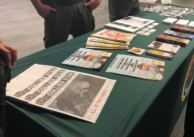 The Collier County Sheriff's Office distributes free gun locks and other safety information to the public at the Naples Daily News in North Naples Aug. 8, 2018. Free sunglasses and pamphlets were handed out.