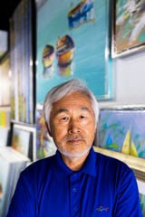 Artist Edward Park stands among his paintings at Naples Fine Arts Studio, his studio space in Naples, on Wednesday, August 8, 2018. Park has been painting for more than 50 years, traveling and selling his art around the country at various art fairs.