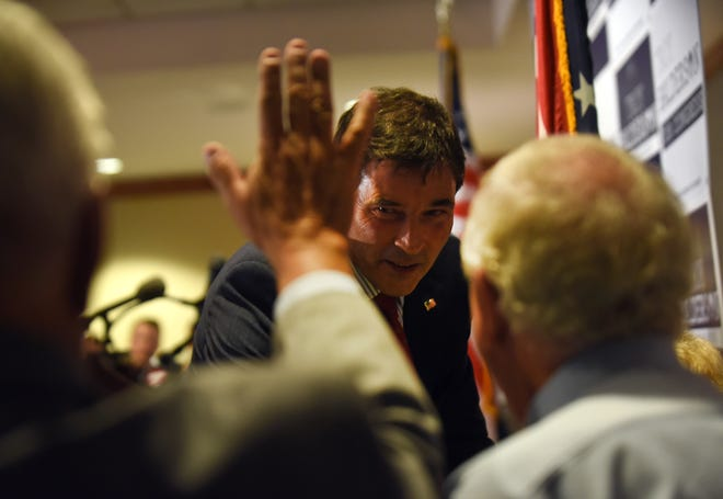 Troy Balderson shakes hands and high fives supporters after his remarks at an election night event in Newark. Tuesday night's special election for Ohio's 12th congressional district was a tight race with Balderson leading O'Connor 50.2 percent to 49.3 percent, a margin of just 1,754 votes.
