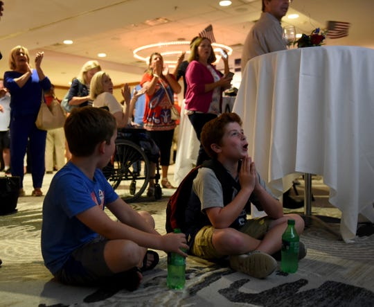 Sam Wegner, 10, and Camden McGovern, 11, watch from the floor in front of a live feed of results during an election night event held by Troy Balderson. The two young Balderson supporters got to meet with Balderson earlier in the evening while he was waiting for results. Tuesday night's special election for Ohio's 12th congressional district was a tight race with Balderson leading O'Connor 50.2 percent to 49.3 percent, a margin of just 1,754 votes.