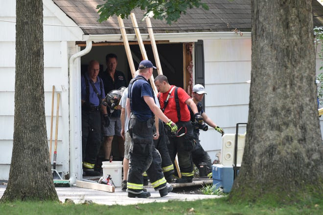 The Wyckoff fire department and EMS respond to a car into the front of 84 Harding Rd. in Wyckoff on Wednesday, August 8, 2018. The front of the house was shored up with pieces of lumber.