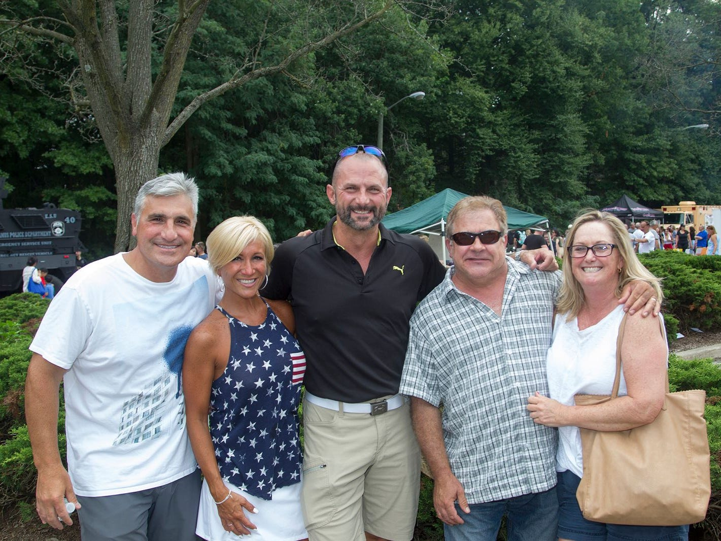 Danny and Gianna Amato, Rick Govel, Jeff Bass, Sharon Bass. Paramus National Night Out 2018 behind Paramus Library. 08/07/2018