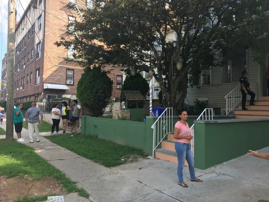 Friends and neighbors of Zaida Polanco discuss the suddeness of her death sometime between Tuesday night and Wednesday morning outside her Passaic home.