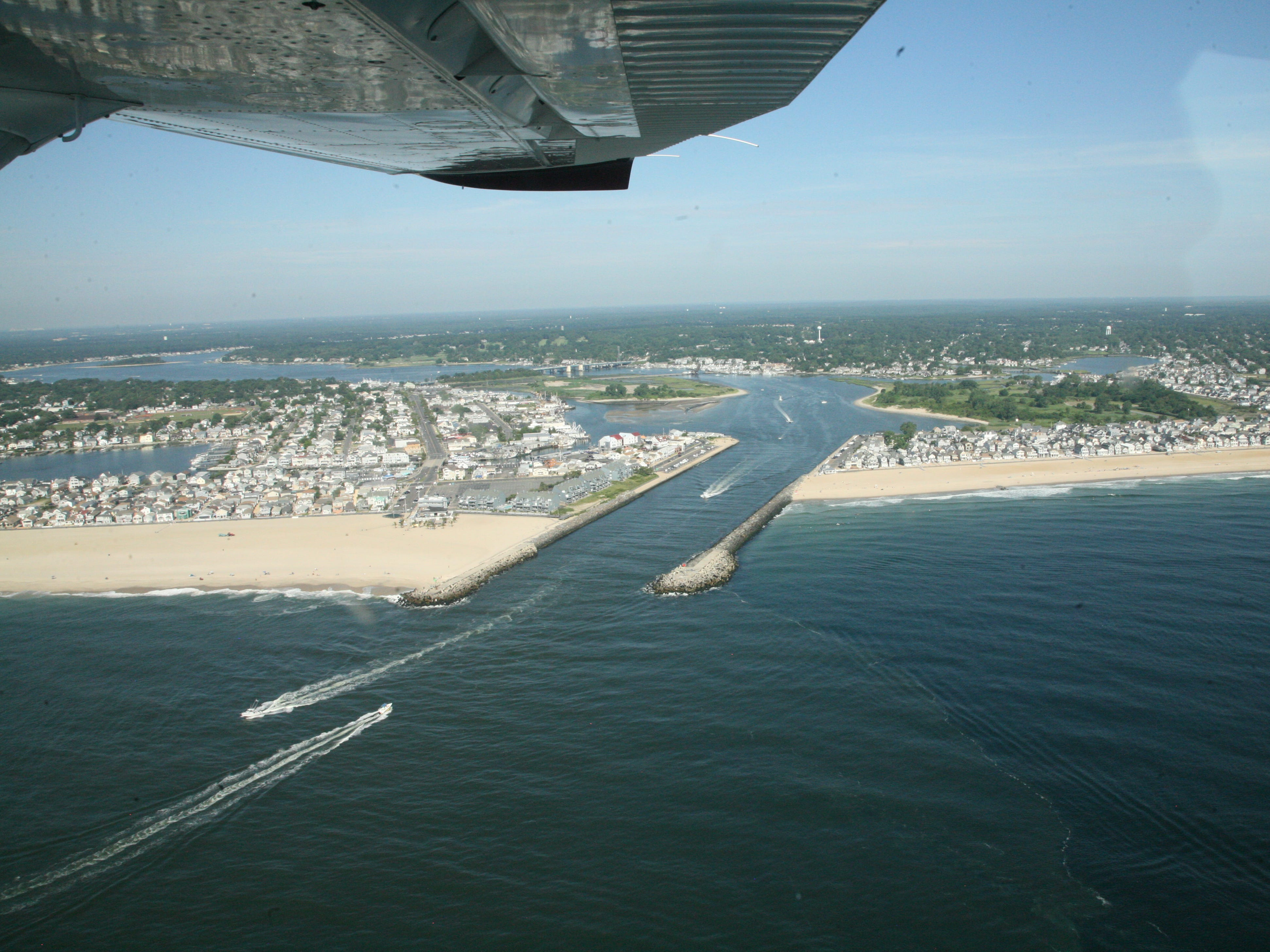 The Manasquan Inlet separates Point Pleasant Beach to the left and Manasquan to the right.