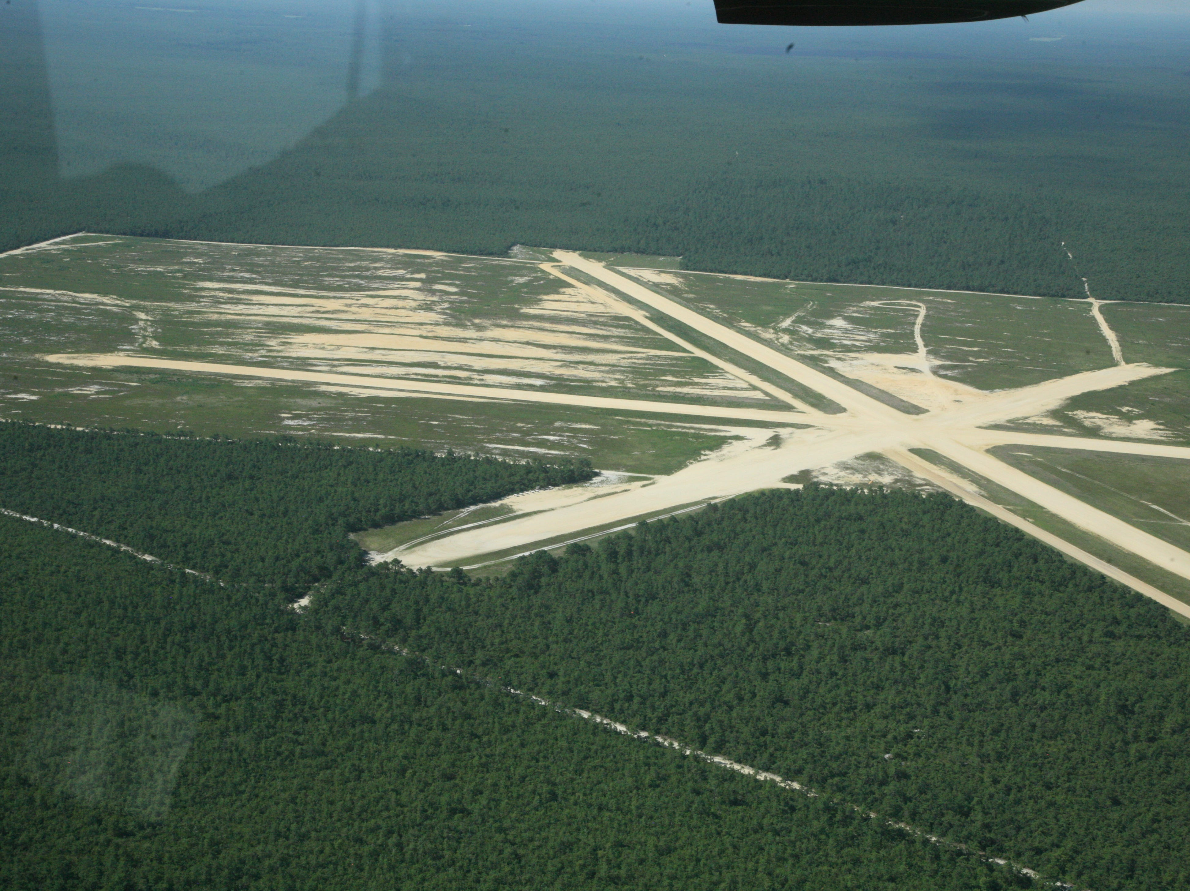 The state Department of Environmental Protection makes aerial survey flights along the Jersey Shore from Coyle Field in Woodland Township, in the Pine Barrens.