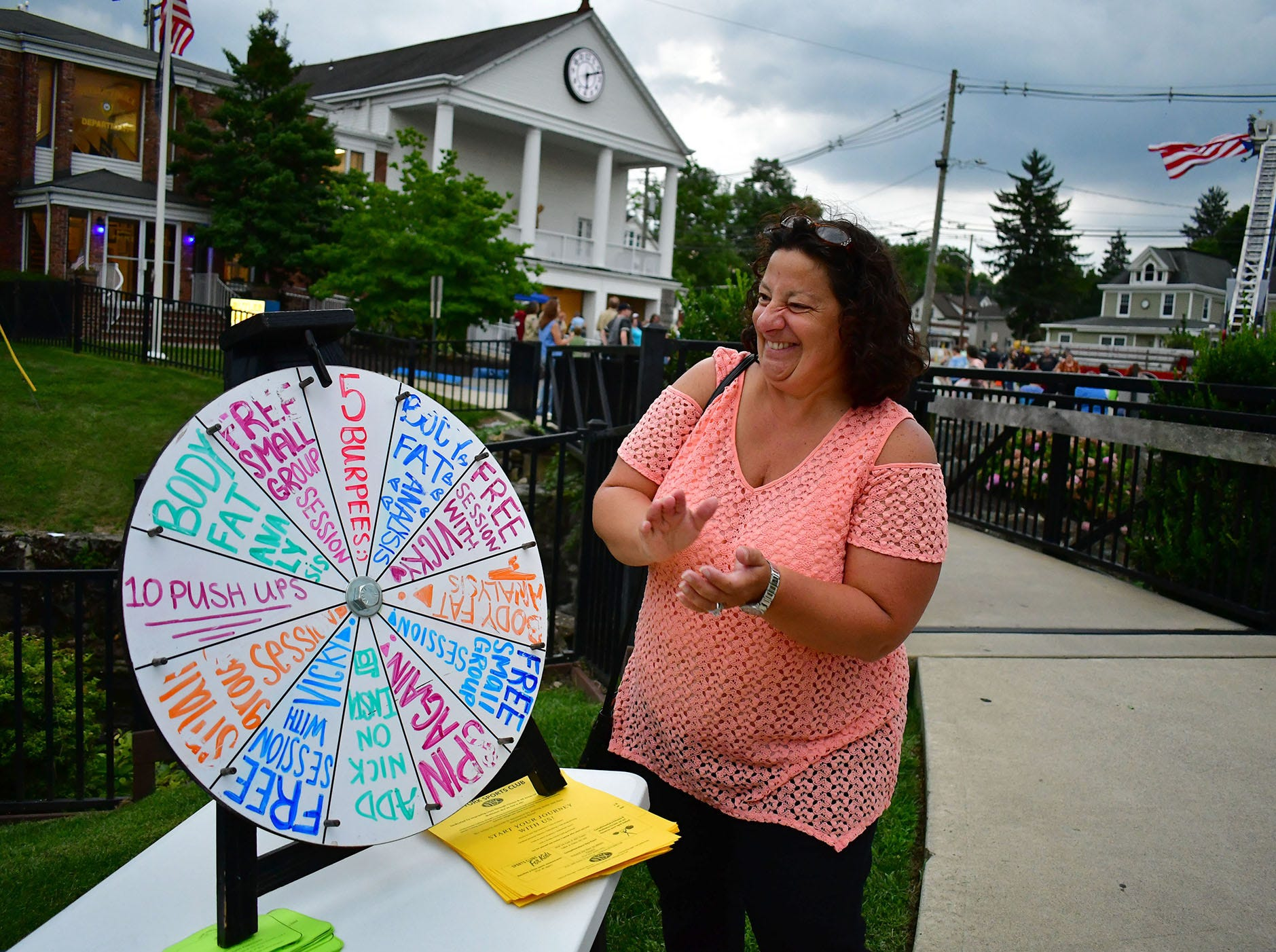 Tammy Sherman, spins the wheel. Butler Police Station hosts National Night Out.  Heavy rain hit and then a rainbow appeared after it, over the station.  In Butler on Tuesday eveningl August 07, 2018.