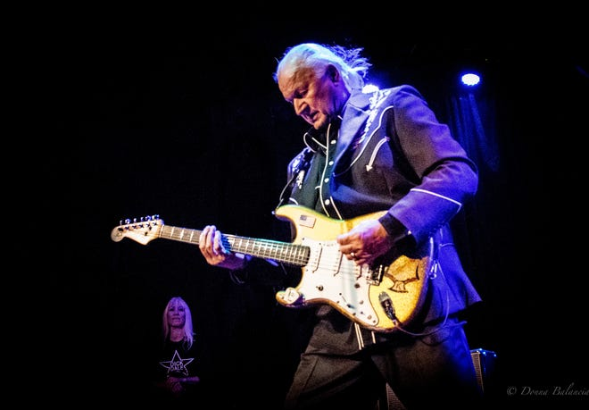 Dick Dale (shown here with his wife, Lana Dale, watching) will play the Newton Theatre on Sunday, August 19. The 81-year-old guitarist emerged in the early 1960s as one of the first proponents of surf guitar, and his style and innovations on guitar design and amplifiers have influenced hard rock and heavy metal.