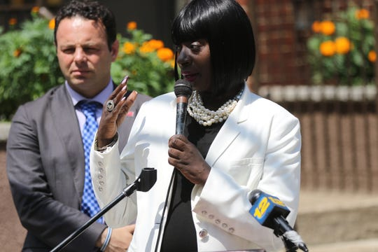 Paterson Councilwoman, Lilisa Mimms is shown with Mayor Andre Sayegh during a press conference to announce the resurfacing of 23 streets later this year.
