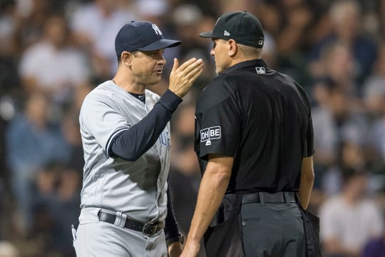 Aug 7, 2018; Chicago, IL, USA; New York Yankees manager Aaron Boone (17) argues a call with home plate umpire Chad Fairchild (4) during the fifth inning against the Chicago White Sox at Guaranteed Rate Field. Mandatory Credit: Patrick Gorski-USA TODAY Sports