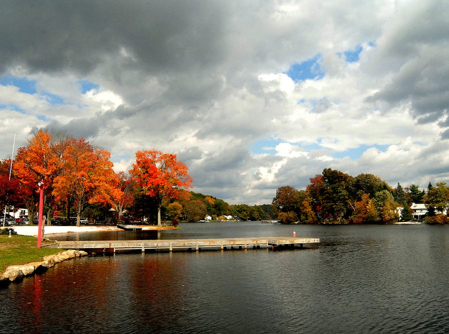 A dramatic sky adds to the brilliance of the trees surrounding Lake Shawnee in this October 2007 view looking north from First Beach.