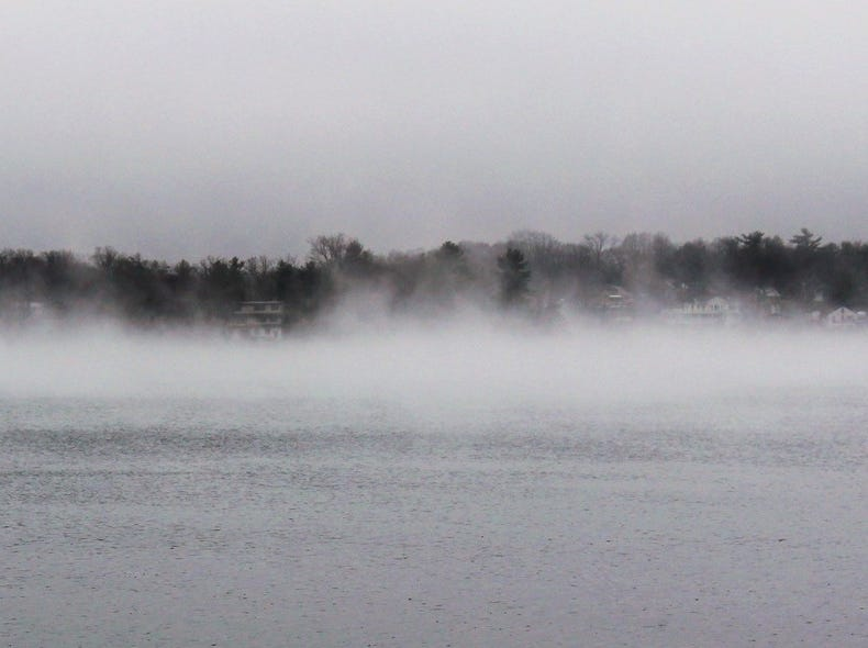 Fog rolls across West Milford's Upper Greenwood Lake on Monday afternoon, April 4, 2016. Local residents endured a variety of weather that day. Morning snow changed to rain before temperatures dropped into the 20s after dark, leaving many surfaces covered with a thin layer of ice.