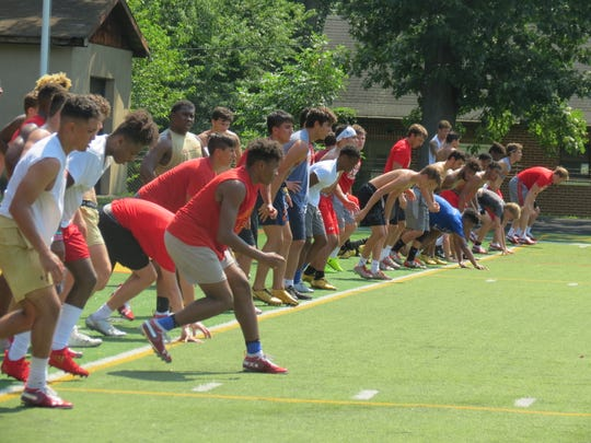Bergen Catholic football players tackle a conditioning drill at the end of a morning preseason practice in Oradell on Wednesday, Aug. 8.