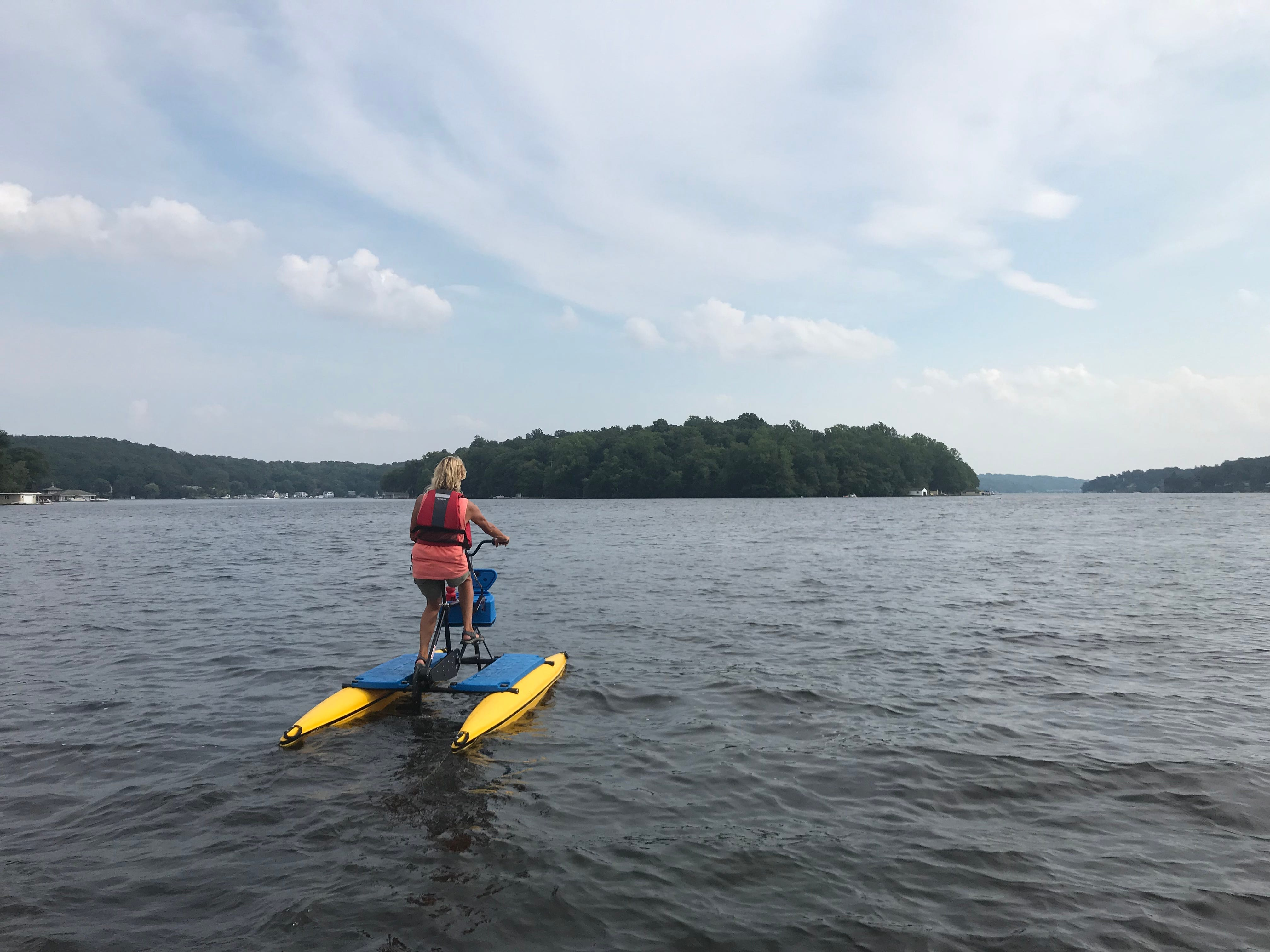 Patty Cinelli, manager at Lake Hopatcong Adventure Club, gives a tour on a hydrobike on Tues., Aug. 7, 2018.
