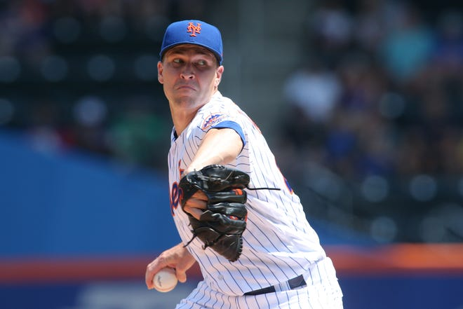 Mets' Jacob deGrom pitches against the Cincinnati Reds during the first inning at Citi Field.