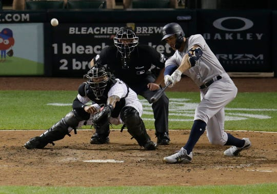 New York Yankees' Giancarlo Stanton hits a home run off of Chicago White Sox relief pitcher Tyler Danish during the 10th inning of a baseball game Tuesday, Aug. 7, 2018, in Chicago.