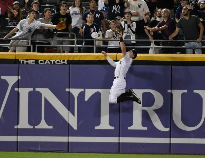 Chicago White Sox center fielder Adam Engel (15) leaps to make the catch on a ball hit by New York Yankees' Kyle Higashioka during the fifth inning of a baseball game Tuesday, Aug. 7, 2018, in Chicago. (AP Photo/David Banks)