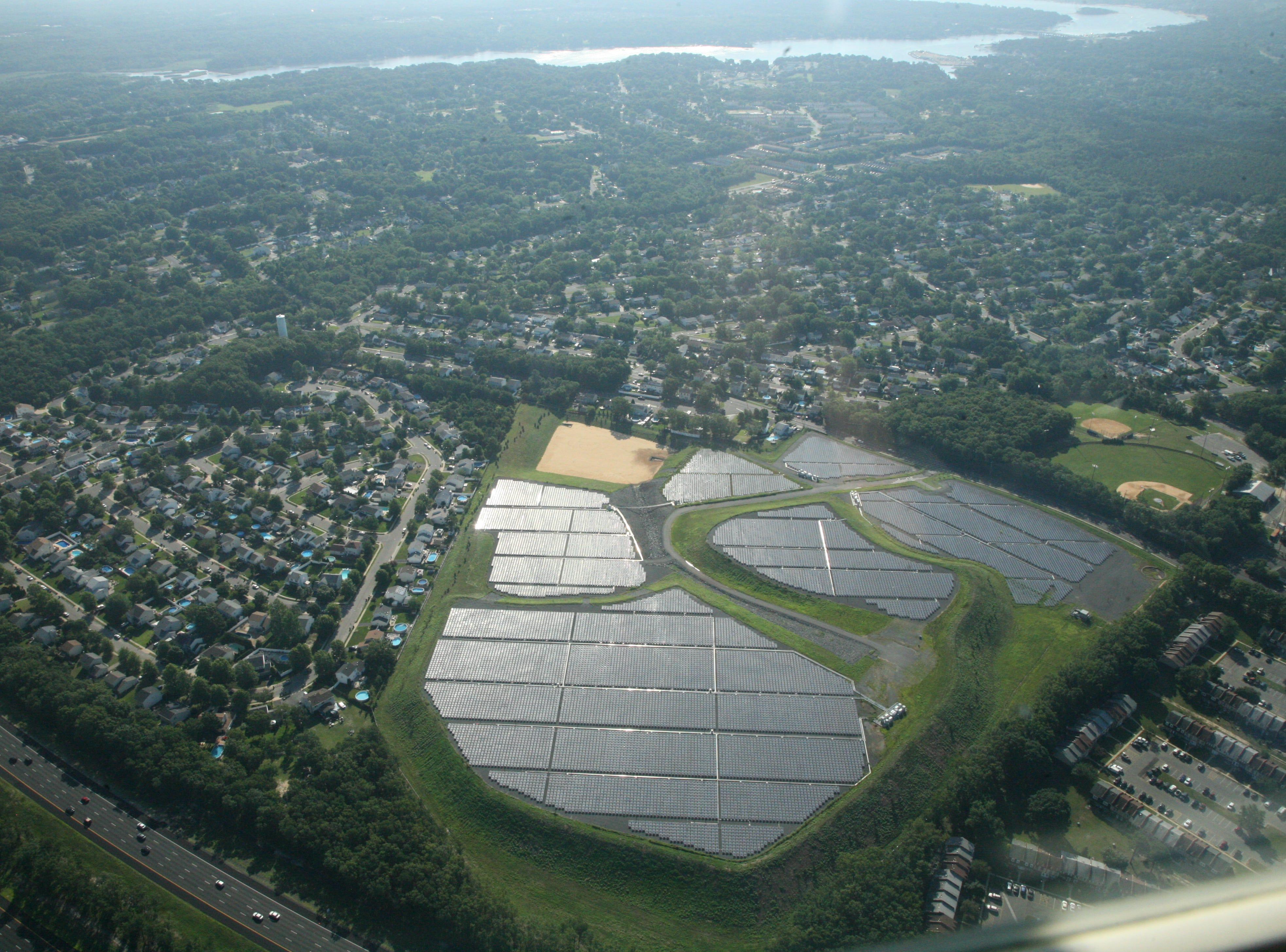 A solar farm near the Garden State Parkway in Brick Township with the Manasquan River to the north.