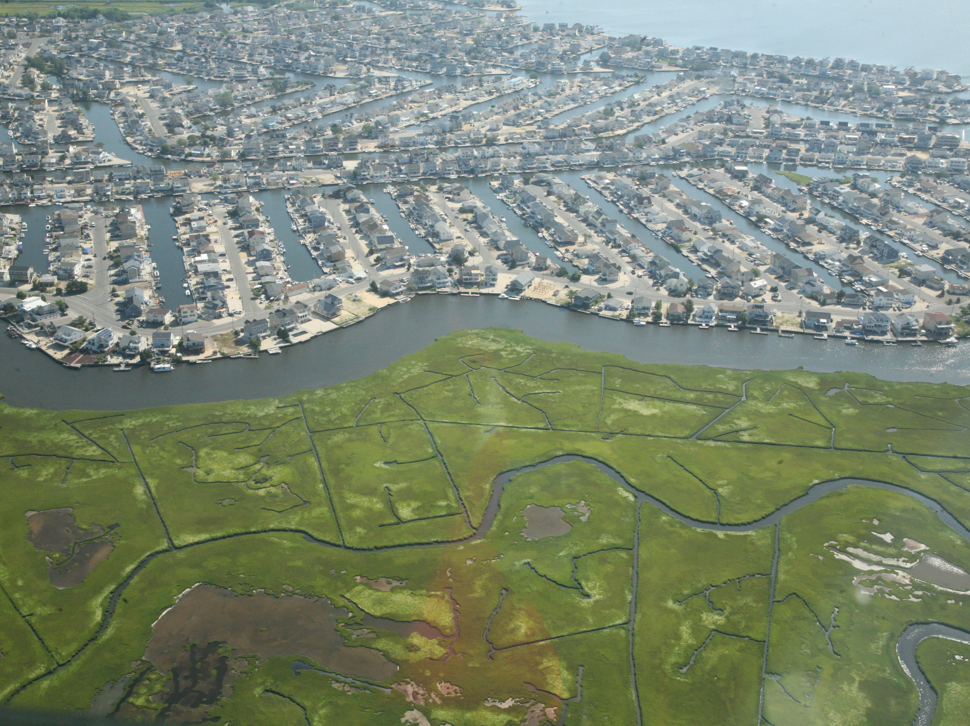 Beach Haven West, a 1950s development in Stafford Township, juts into the salt marsh along  Mill Creek and Manahawkin Bay.